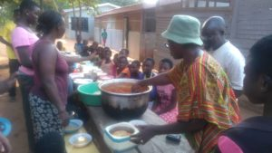 Feeding orphans at King Jesus Orphanage, Ghana