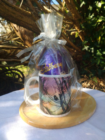 The Cadbury Dairy Milk egg sits neatly in a mug and comes cellophane wrapped